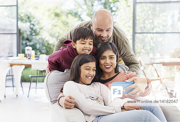 Family taking selfie with camera phone