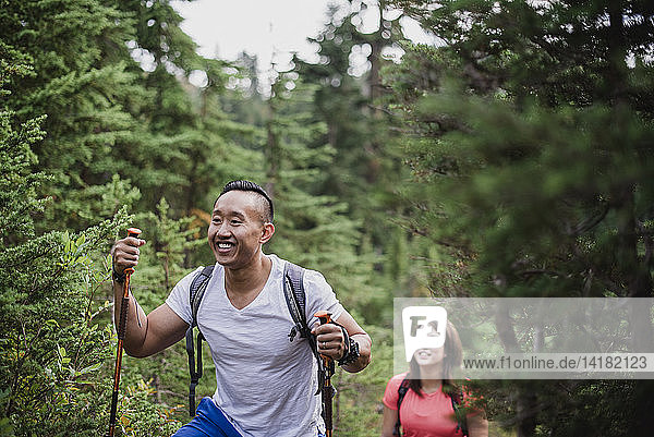 Happy couple hiking in woods
