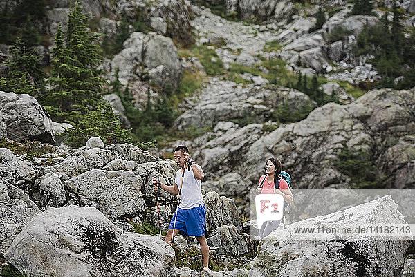Couple hiking through rugged landscape