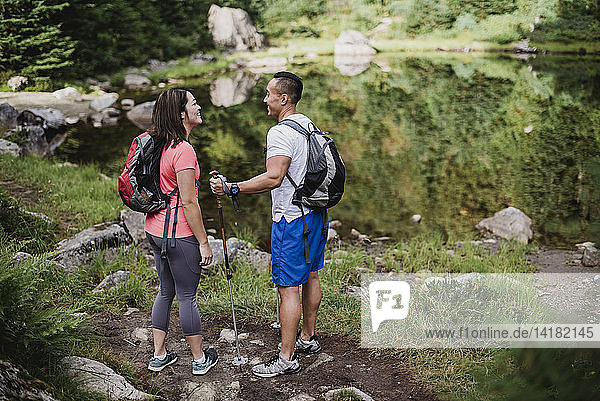 Couple hiking at lake in woods