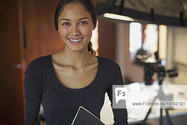 Portrait smiling  confident female photographer in studio