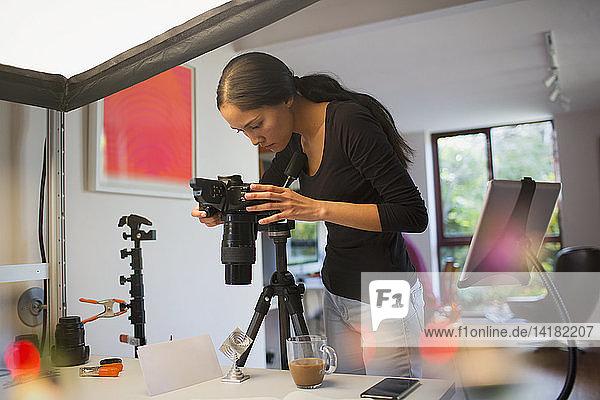 Female photographer working in studio