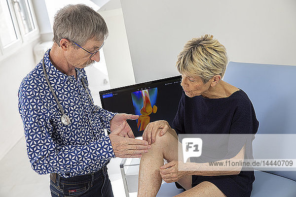 Woman consulting a doctor for a pain in her knee.