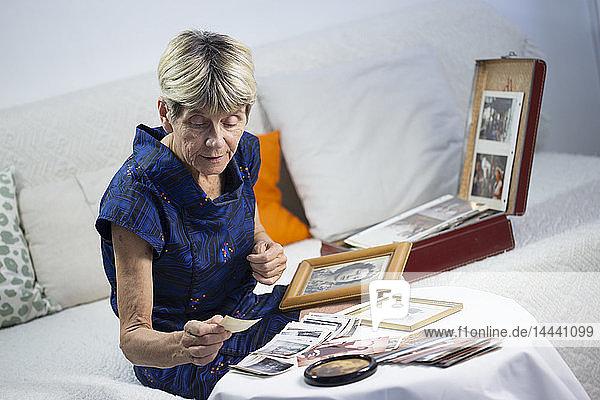 Old woman looking at photos