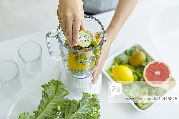 Japanese woman making smoothie in the kitchen