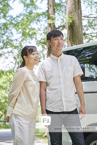 Japanese couple in a city park