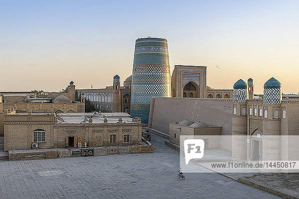 Elevated view over the courtyard of historic monuments with Kalta Minor minaret in the centre of Khiva  Uzbekistan.