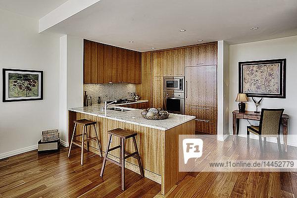 Wood cupboards in modern kitchen