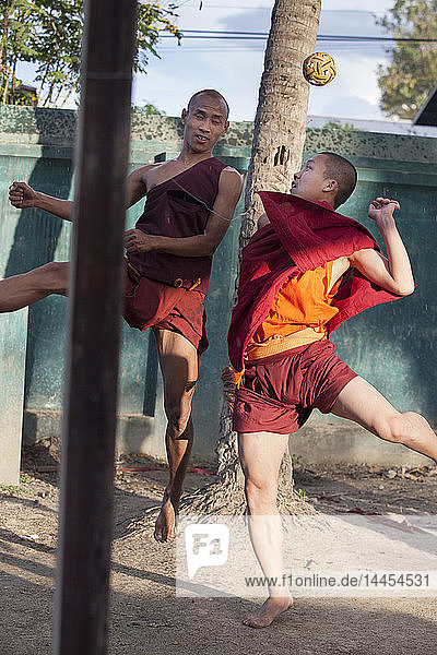 Young monks playing Sepak takraw  Nyaungshwe  Burma