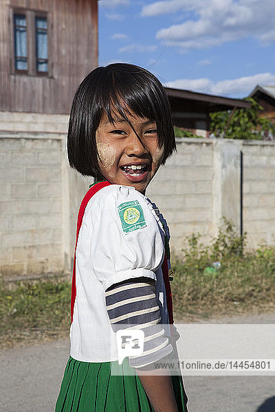 Young girl coming back home from school in uniform  Nyaungshwe  Myanmar