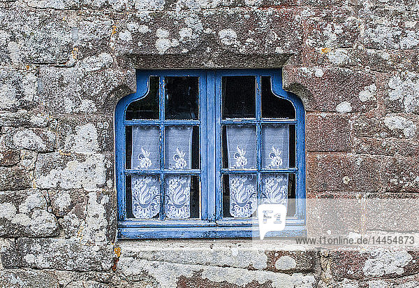 """France  Brittany  Locronan (part of the French assocation Plus Beaux Villages de France  meaning """"the most beautiful villages of France )  window on a granite facade (on the French Way of St. James)"""