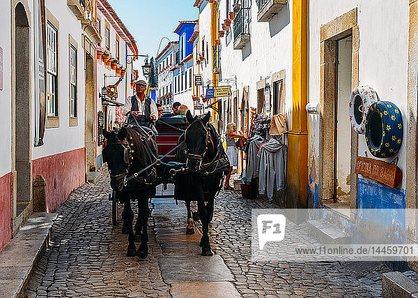 Horse-drawn carriage within the ancient fortified village of Obidos  Oeste Leiria District  Portugal