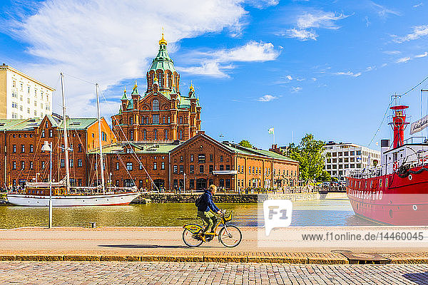 Uspenski Cathedral and cyclist by harbor in Helsinki  Uusimaa  Finland
