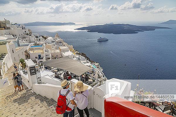 View of Fira restaurants and cruise ship  Firostefani  Santorini (Thira)  Cyclades Islands  Greek Islands  Greece