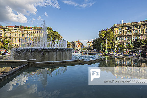 View of fountain close to Castello Sforzesco (Sforza Castle) on a bright sunny day  Milan  Lombardy  Italy