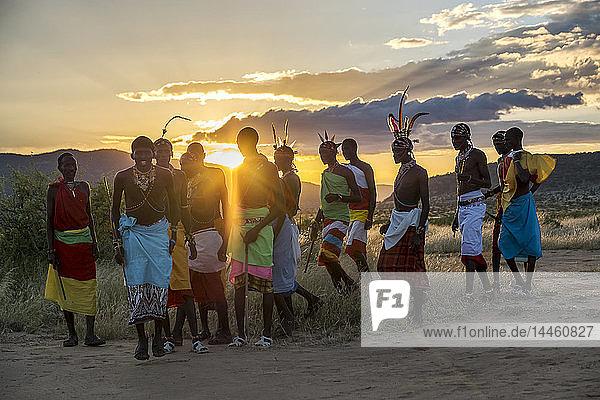 Portrait of Samburu tribe members dancing the traditional wedding dance at dusk  Kenya  East Africa
