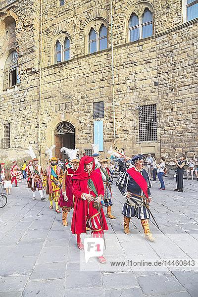 Men marching in costume during Calcio Storico Fiorentino festival at Piazza della Signoria in Florence  Tuscany  Italy
