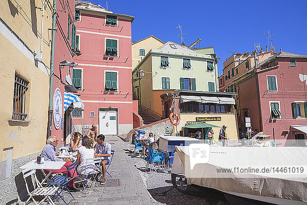 People dining at cafe in Boccadasse fishing village  Genoa  Liguria  Italy