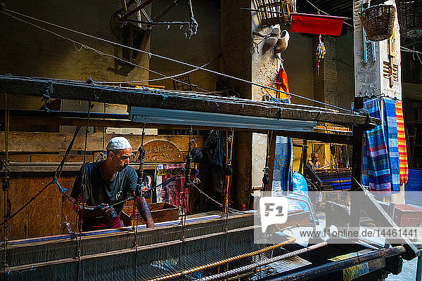 Weaver at work at loom in shop in the Old City (Medina) of Fez  UNESCO World Heritage Site  Morocco  North Africa