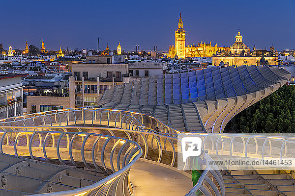 View from the top of Metropol Parasol over the city centre at dusk  Seville  Andalusia  Spain