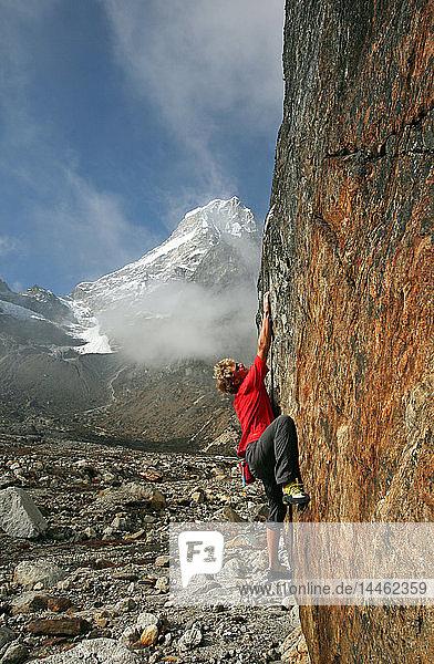 Climber bouldering at Tangnag moraine  Khumbu  Himalayas  Nepal