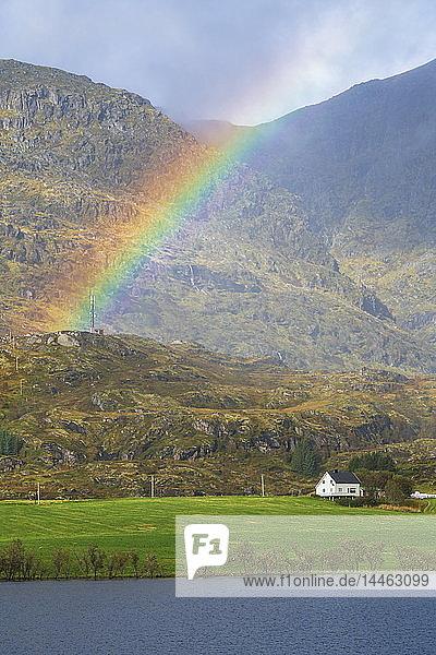 Rainbow over mountain in Leknes  Lofoten Islands  Norway