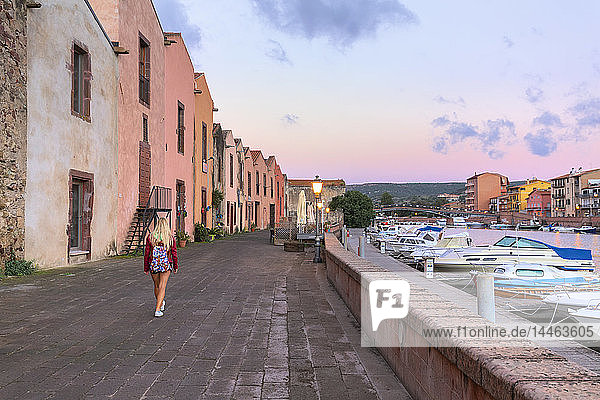A girl walks at sunrise  Bosa  Oristano province  Sardinia  Italy  Mediterranean