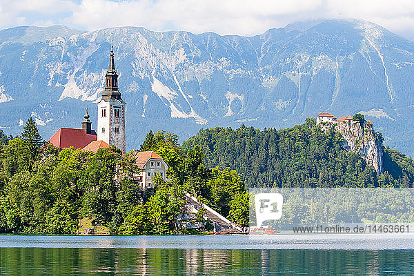 Tiny island with a church  a castle on a crag  and mountain views  Lake Bled  Slovenia