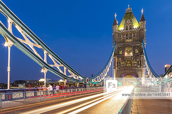 Light trails on Tower Bridge at sunset in London  England