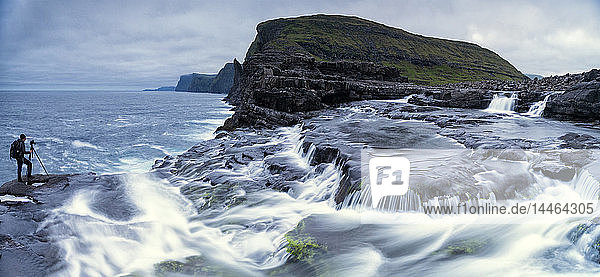 Panoramic of photographer at Bosdalafossur waterfall  Vagar island  Faroe Islands  Denmark
