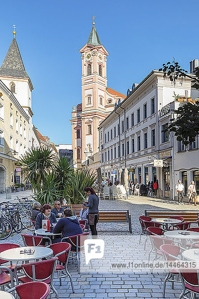 Cafe on Rindermarkt square by St. Paul Church in Passau  Germany