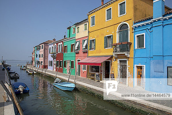 Colorful buildings on canal in Burano  Italy