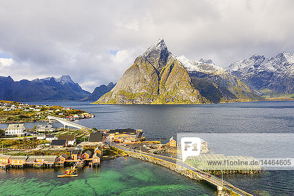 Sakrisoy village surrounded by mountains and crystal sea  Reine  Nordland  Lofoten Islands  Norway  Europe