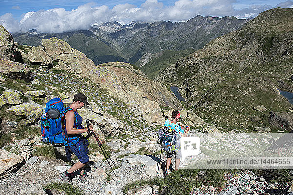 Walkers descend from the top of Pic Peyreget while hiking the GR10 trekking trail  Pyrenees Atlantiques  France