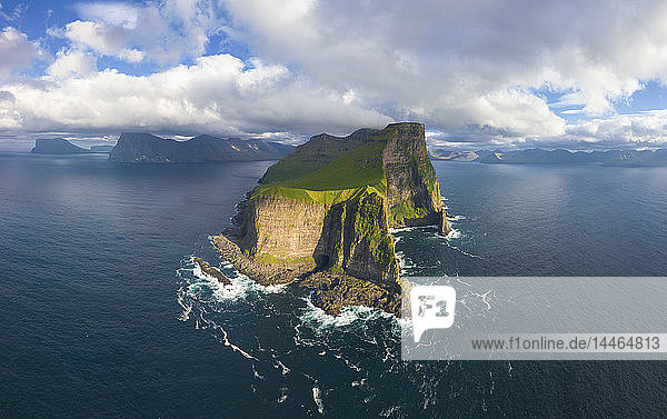 Aerial panoramic of Kallur lighthouse and cliffs  Kalsoy island  Faroe Islands  Denmark