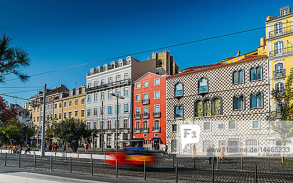 Traditional buildings with azulejo tiles in the old Lisbon neighbourhood of Alfama with Se Cathedral in background  Lisbon  Portugal