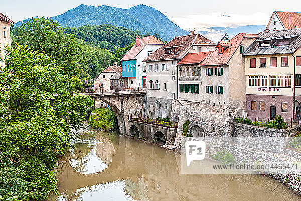 Houses lining a river  Skofja Loka village  near Ljubljana  Slovenia