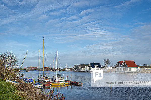 Germany  Lower Saxony  Harlesiel  Holiday homes at the shores of Harle river