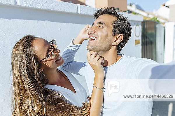 Happy playful couple outdoors on a sunny day