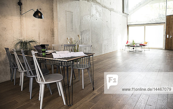 Sitting area in a loft at concrete wall