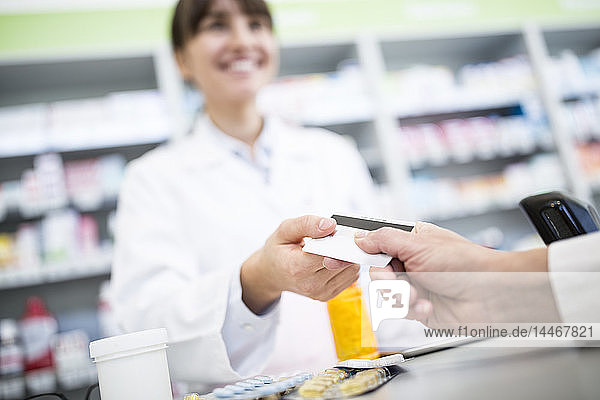 Customer paying cashless in a pharmacy