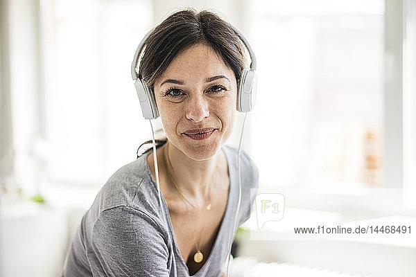Portrait of a woman  wearing headphones