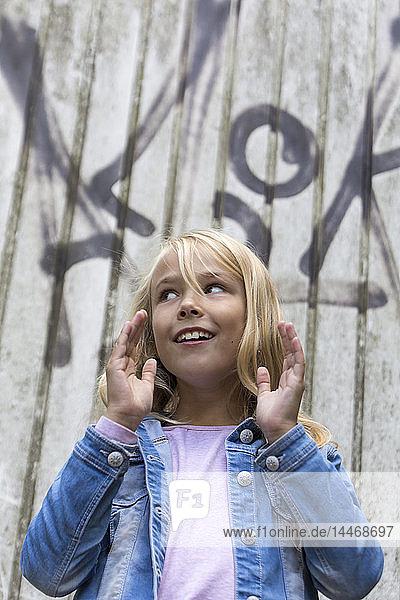 Portrait of gesturing blond girl