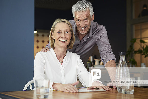 Portrait of smiling mature couple at home