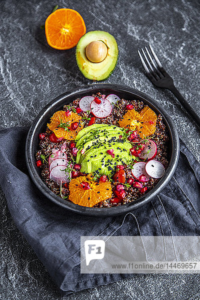 Red Quinoa salad with avocado  tomatoes  red radishes  pomegranate seeds  black sesame and cress