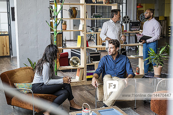 Business team having an informal meeting in loft office