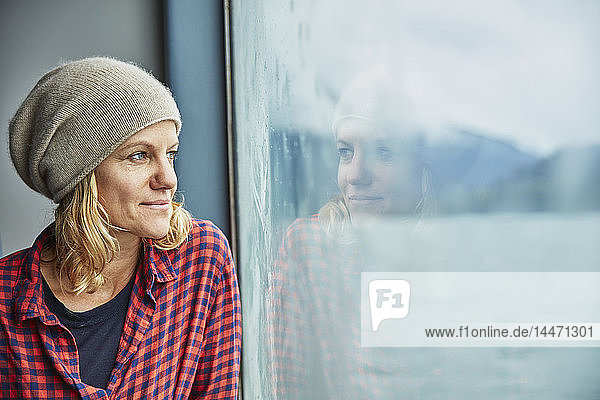 Chile  Hornopiren  portrait of woman looking out of window of a ferry