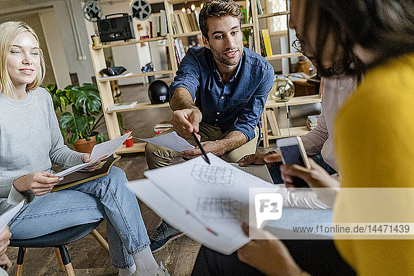 Business team discussing during a meeting in loft office