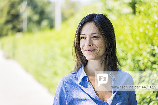 Portrait of a beautiful woman in nature