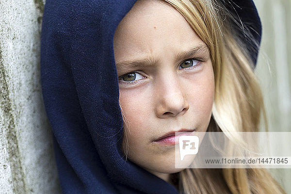 Portrait of unhappy blond girl